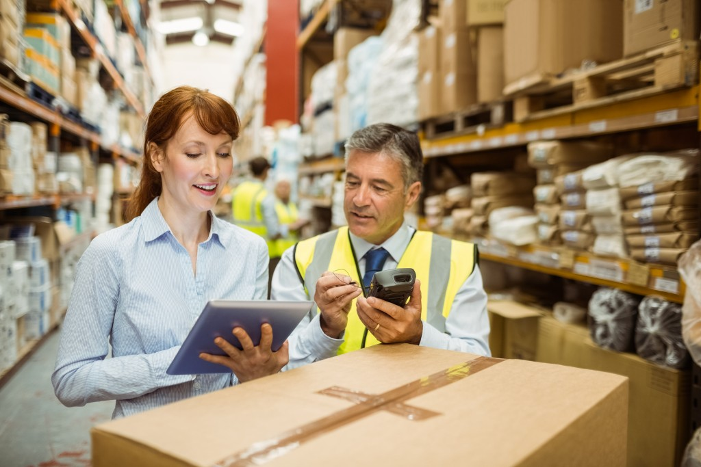 Warehouse managers looking at a tablet