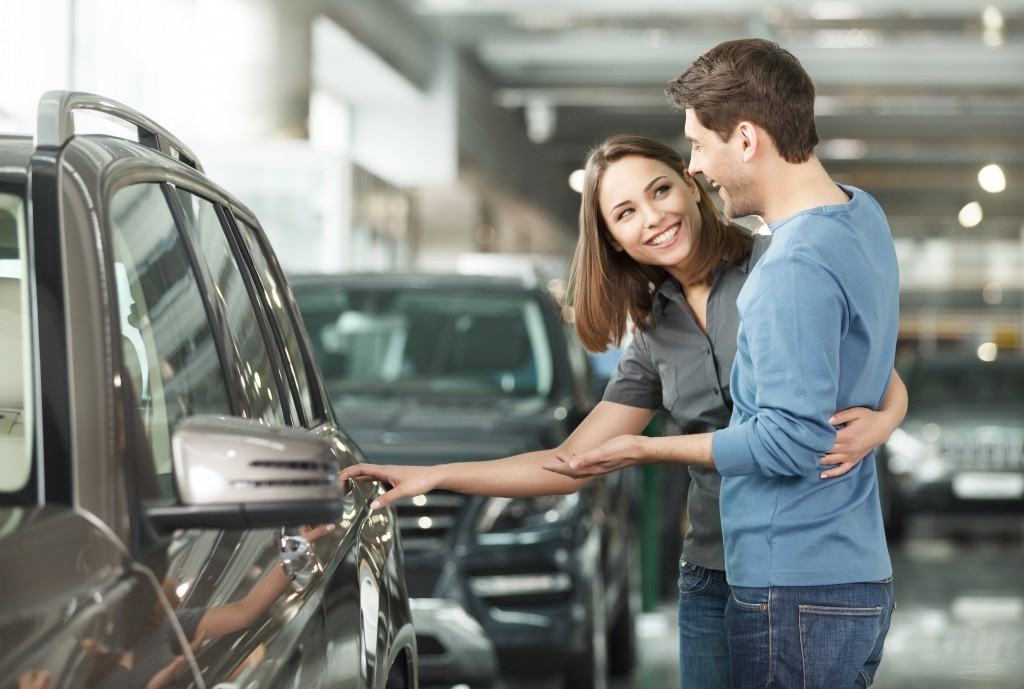 Couple choosing a car to buy
