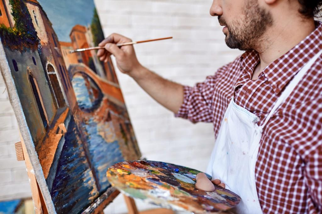 Artist painting a landscape
