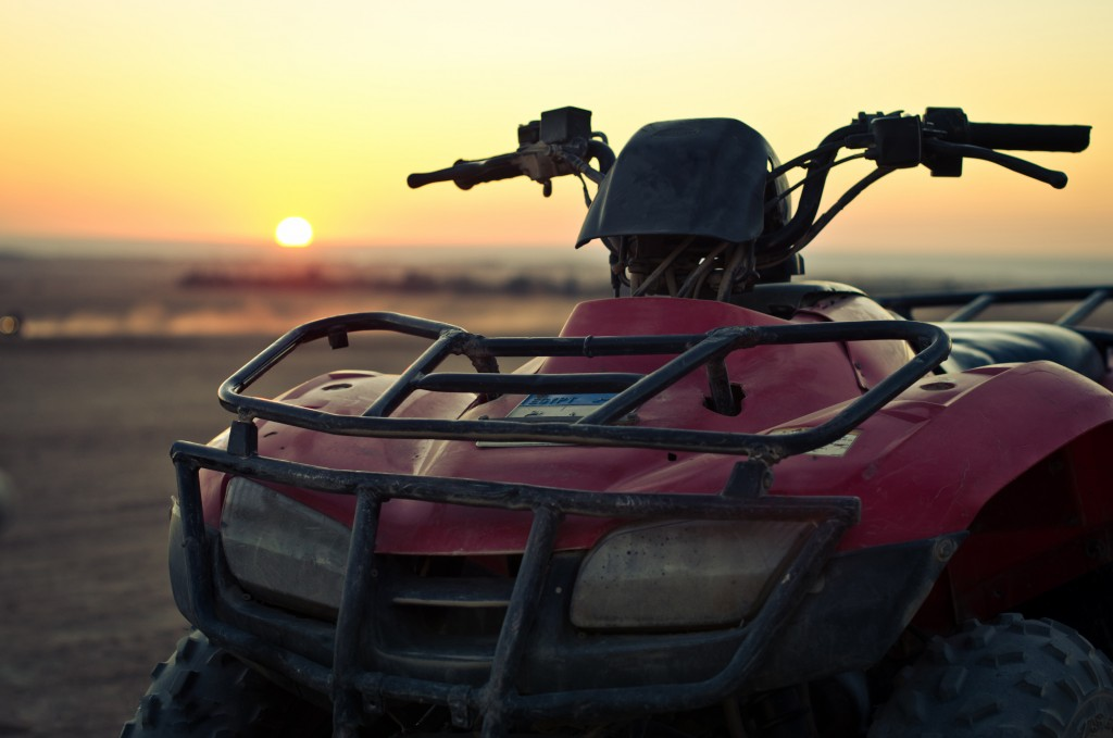 Photo of a red ATV during sunset