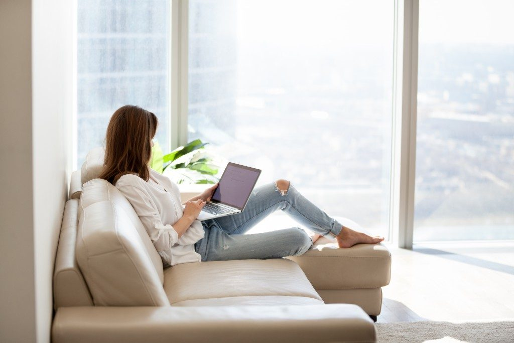 woman using laptop in the couch