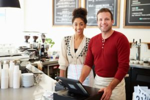 Man and woman by the cashier in cafe