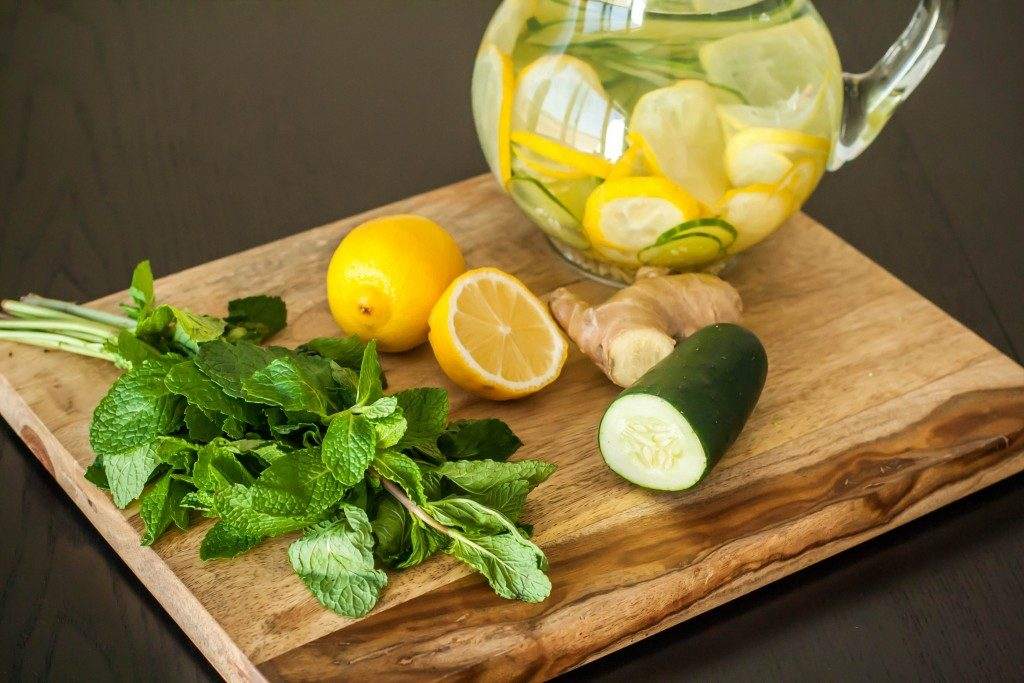 lemon and cucumber on a chopping board