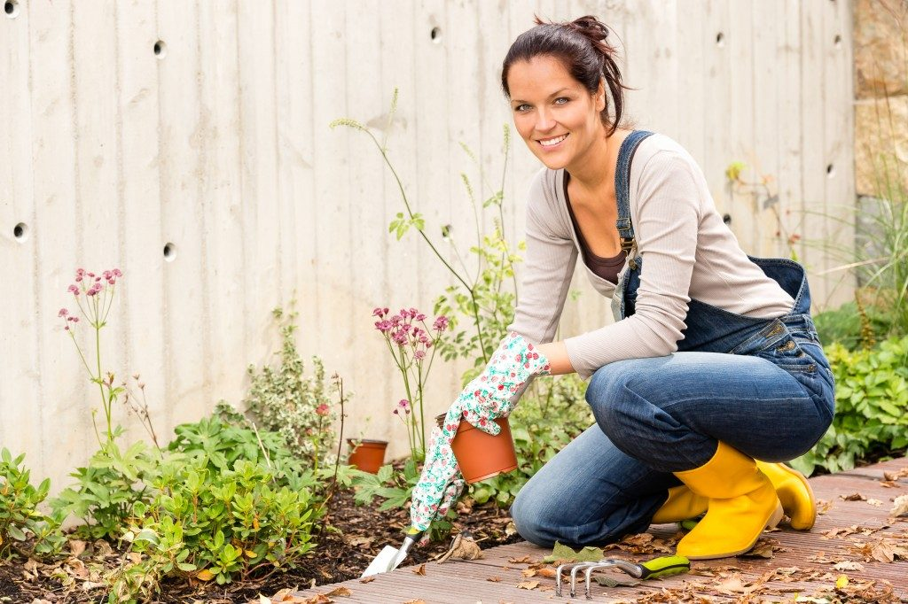 woman planting in her garden