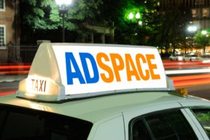 Taxi billboard close-up at night