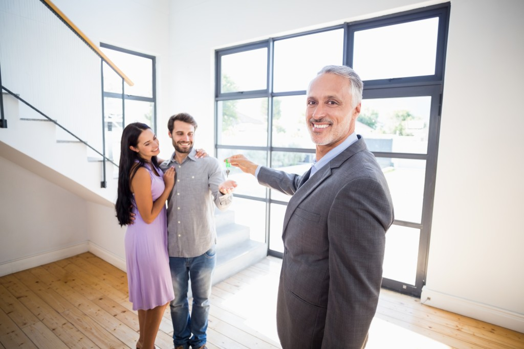 Realtor showing a house to the couple