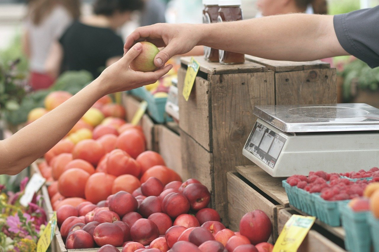 person buying apples