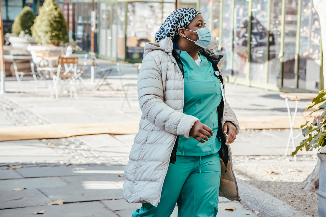 a nurse walking down the street