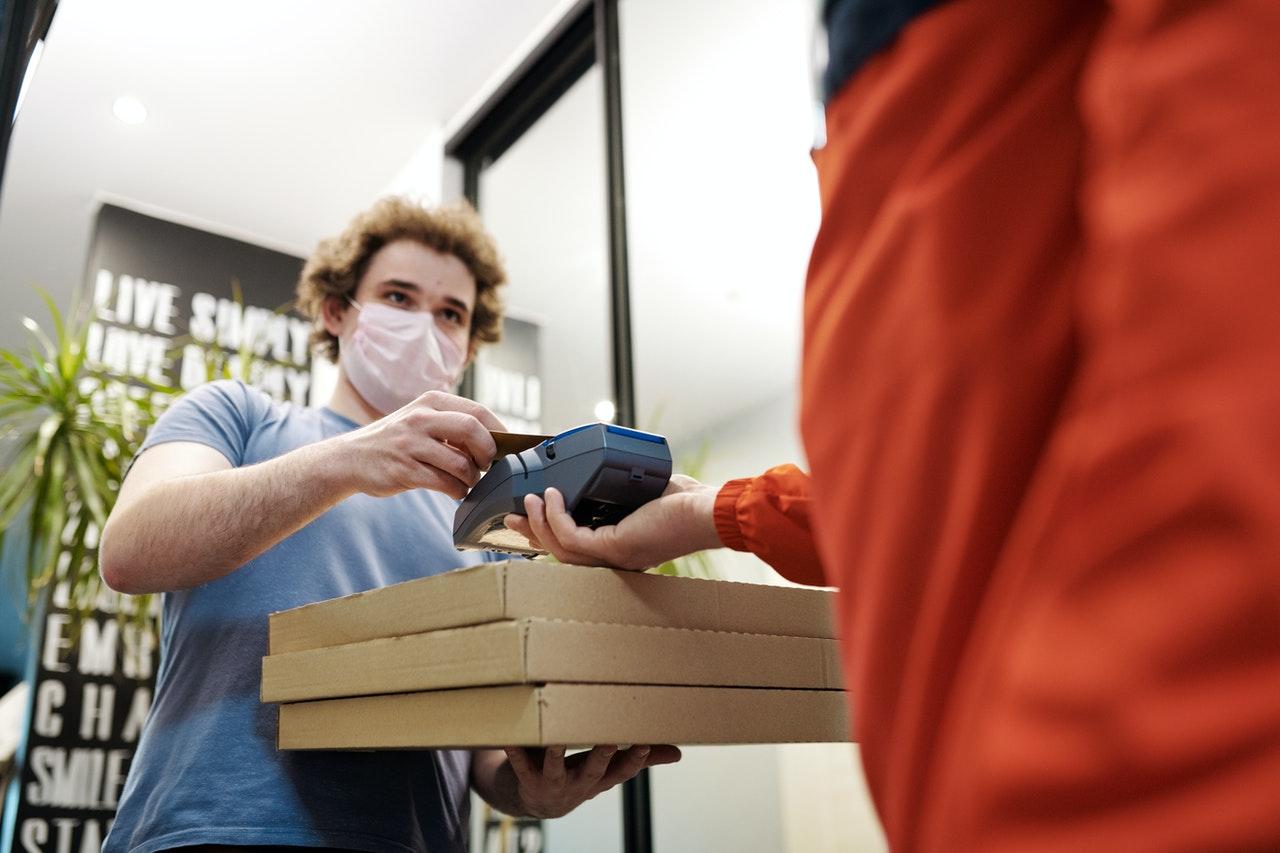 a deliveryman receiving payment