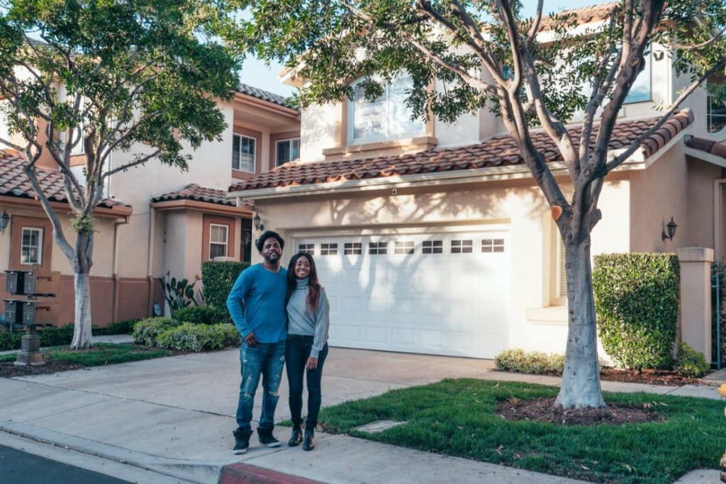 couple in front of a house