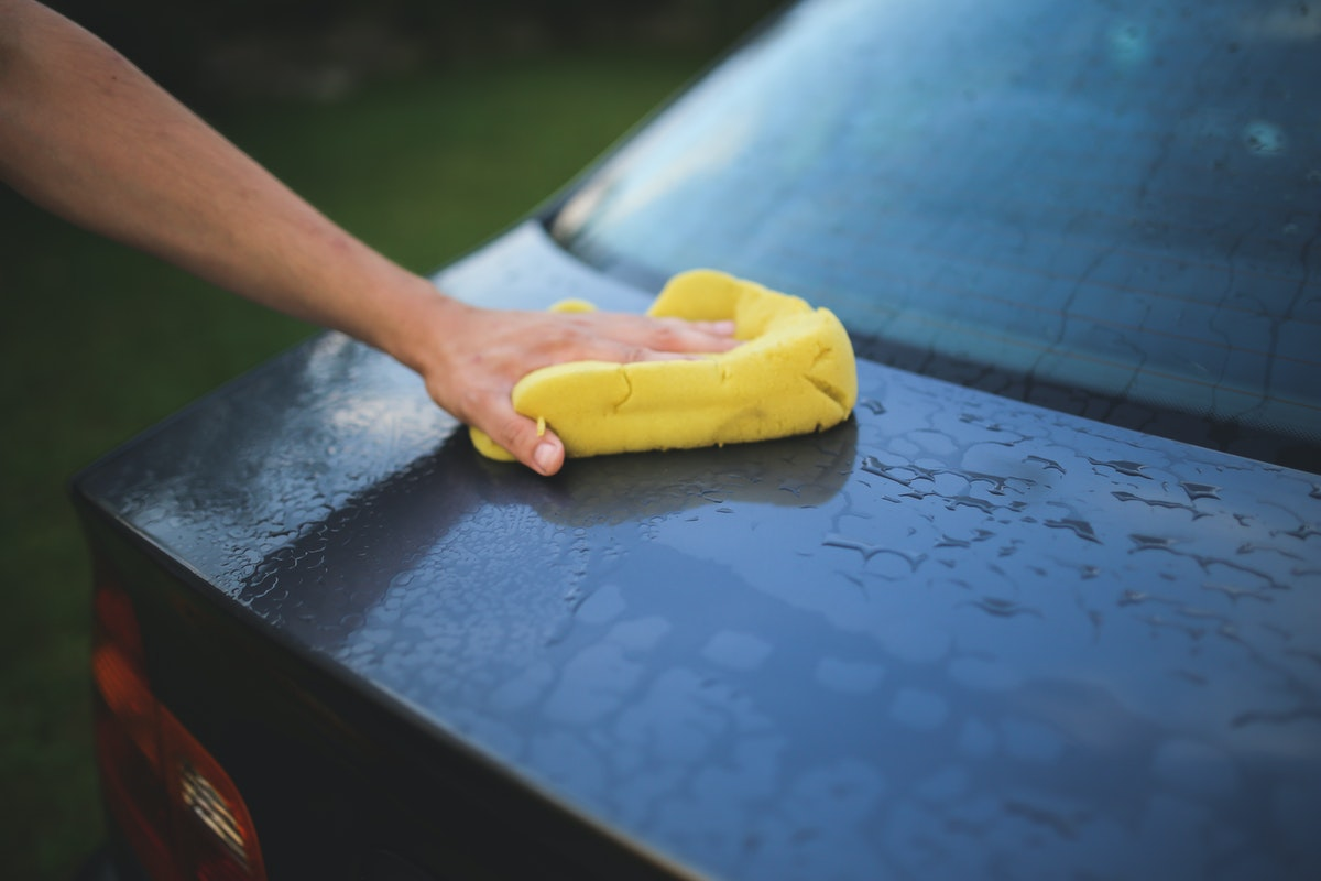 person doing a car wash