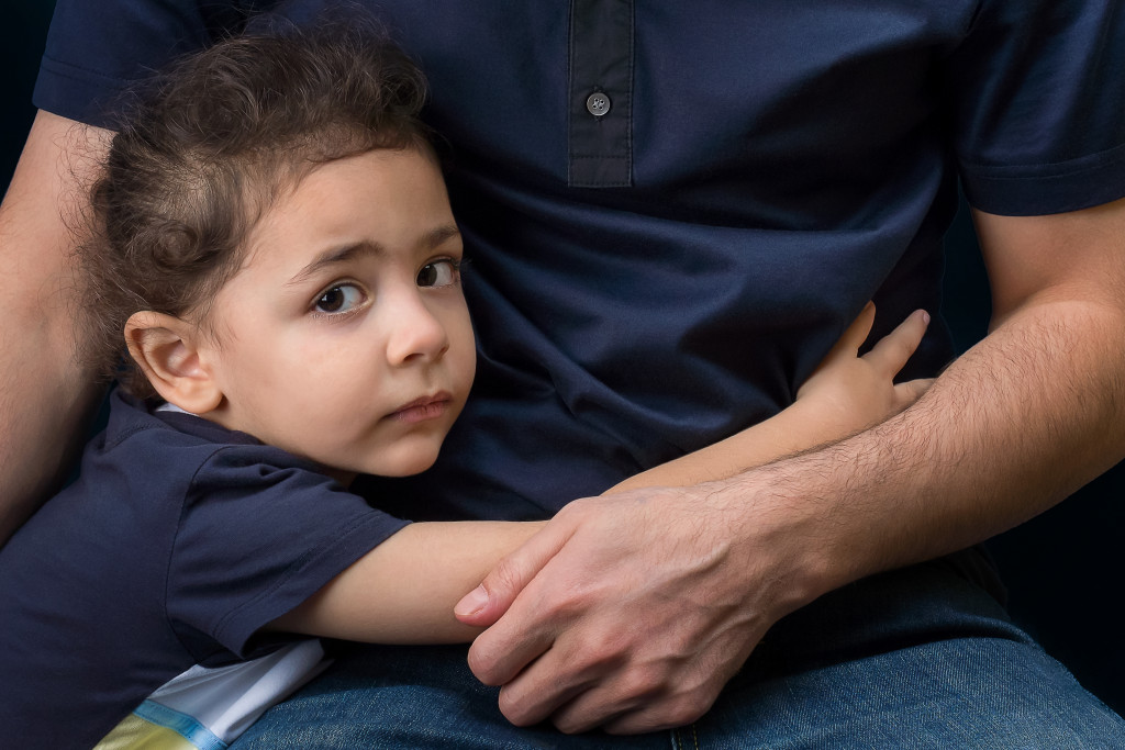 child hugging dad