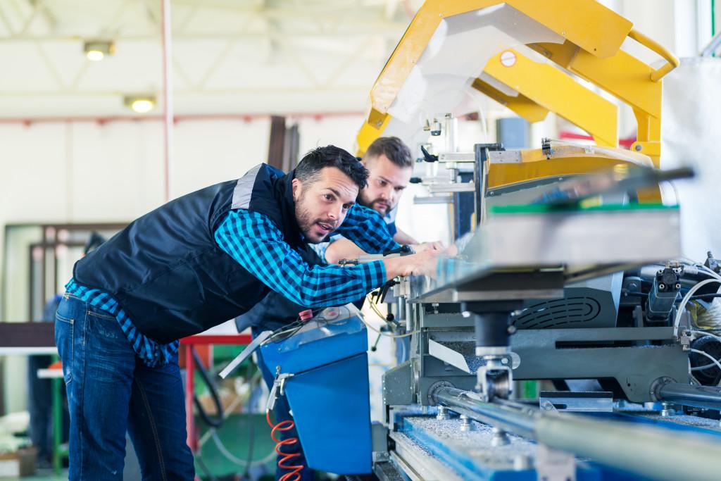 men inspecting a machine
