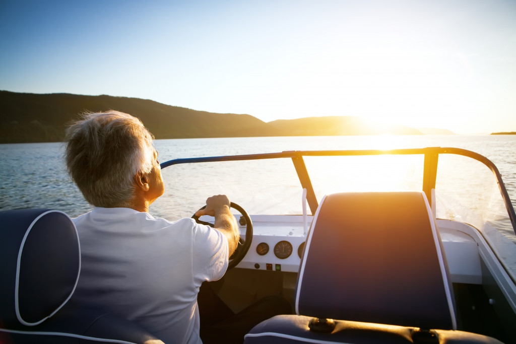 man driving a boat