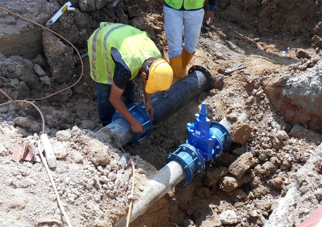 men installing plumbing