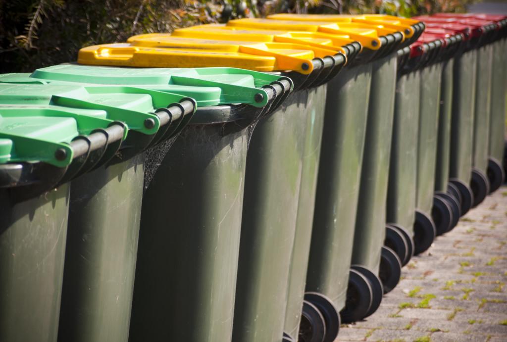 trash bins lined up outside