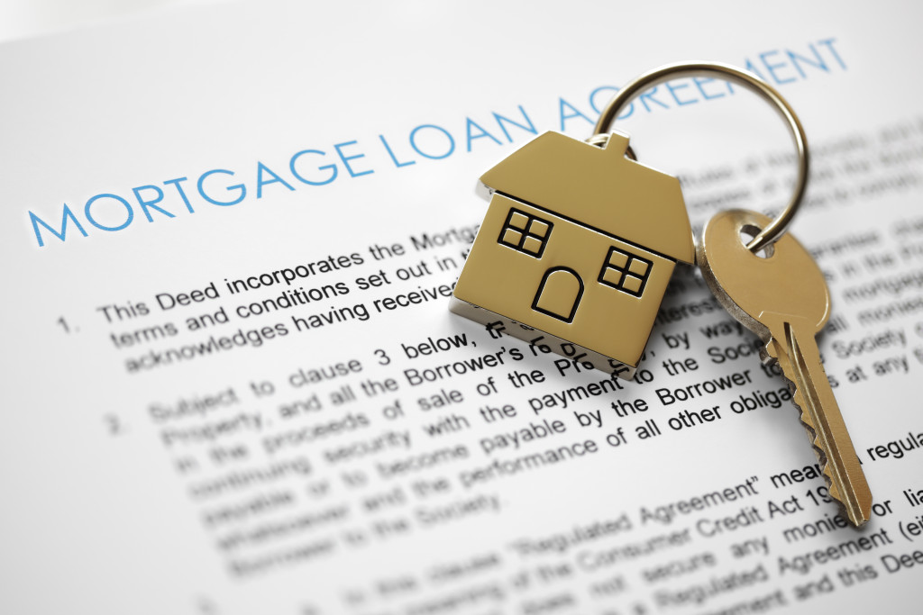 mortgage loan agreement written on paper with a house key