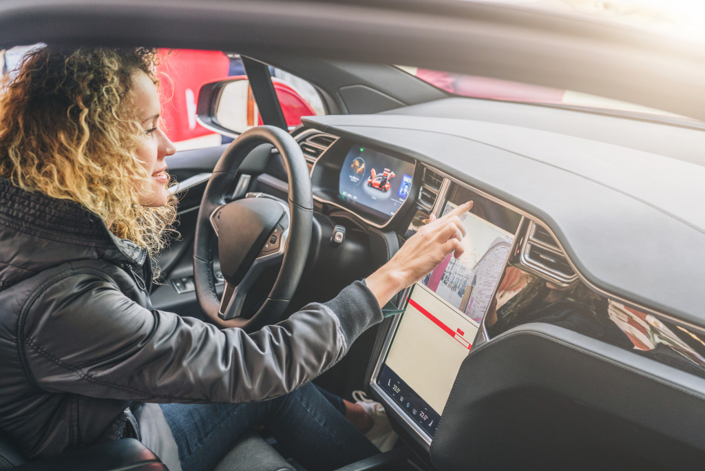 woman using her car's electronic dashboard