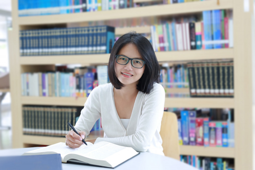 entrepreneur studying in the library